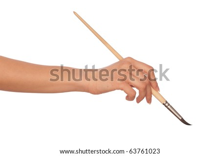 woman drawing a picture with a brush - stock photo