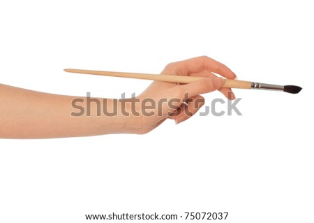 woman drawing a picture with a brush
