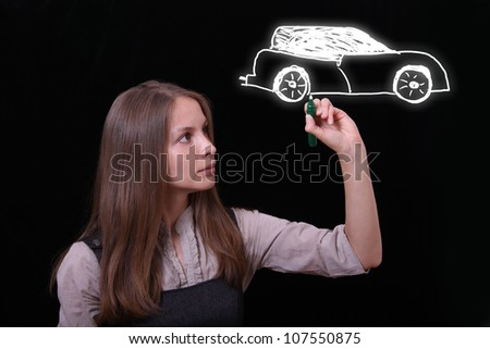 woman drawing car on black background