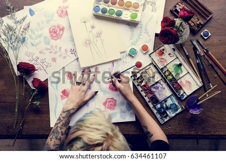 Woman drawing colorful flower in aerial view
