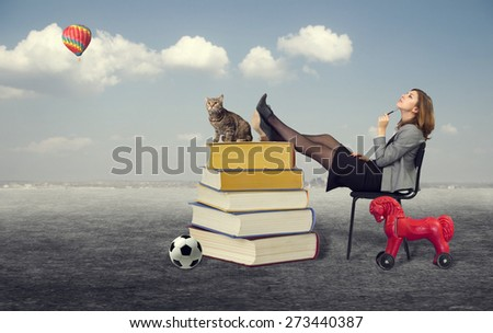 woman dreaming sitting on a chair in the open air.