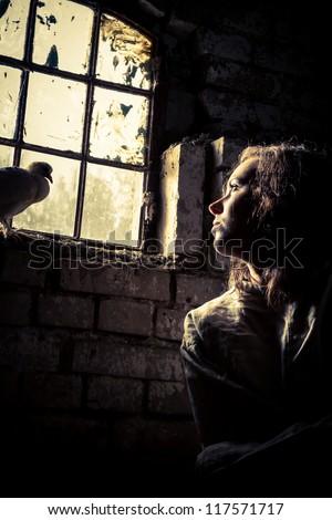 Woman dreams of freedom in a prison psychiatric - stock photo