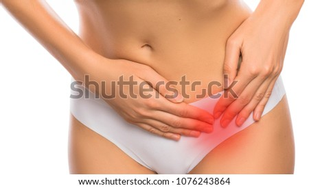 woman dressed in underwear, suffering from menstrual pain, pain in the ovary , isolated on white
