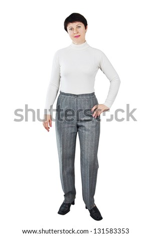 Woman Dressed In White Turtleneck And Grey Trousers