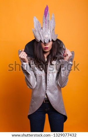 Woman dressed in witch halloween costume over yellow background.Voodoo costume, Scary costume,.