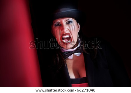 Woman dressed like a circus ringmaster