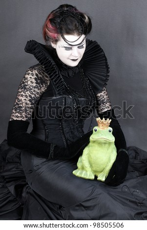 Woman dressed up in gothic style as dark queen in ancient victorian