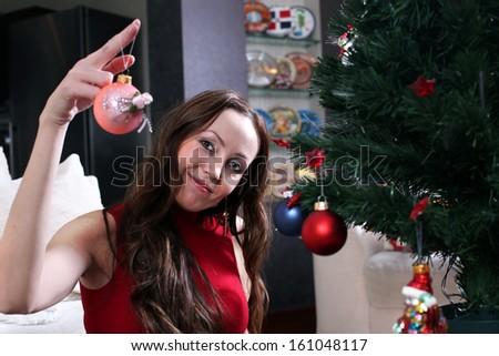 Woman dresses up Christmas tree