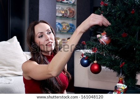 Woman dresses up Christmas tree