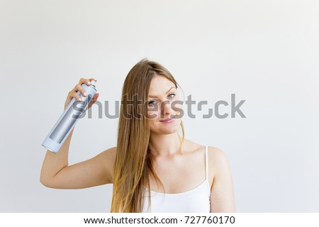 Woman dries and styles her hair