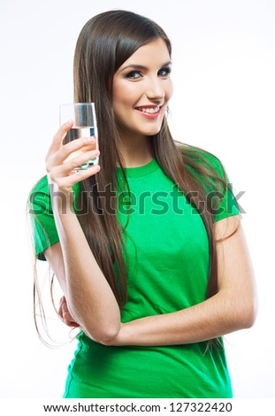 Woman drink water, hold glass standing against white background