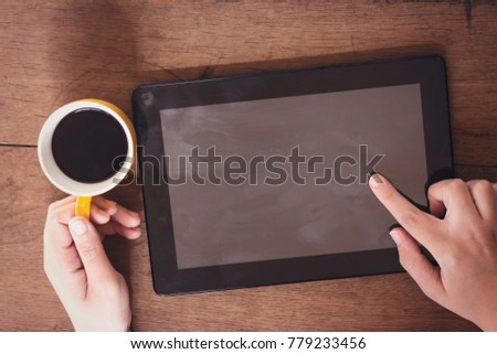 woman drinking an arabic coffee and using tablet #779233456