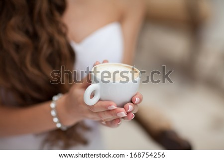 woman drinking coffee at cafe restaurant girl with cup of espresso hot cappuccino. Woman with mug of chocolate with caffeine. Coffee for breakfast. Italian coffee. delicious drink aroma latte. Concept