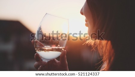 woman drinking cooled white...