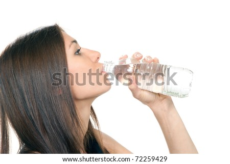 Woman drinking mineral water. Female holding in hand and drink sparkling still mineral bottled water isolated on a white background. Healthy lifestyle concept