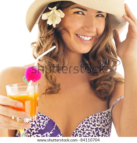 Woman drinking orange juice and wearing summer hat. Vacation concept