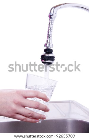 Woman drinking water from the faucet.
