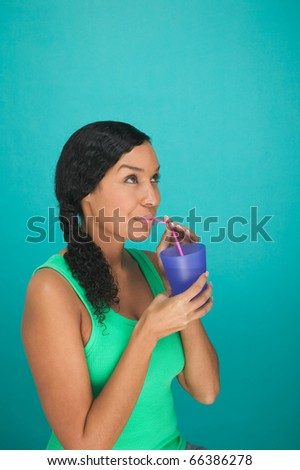 Woman drinking with straw