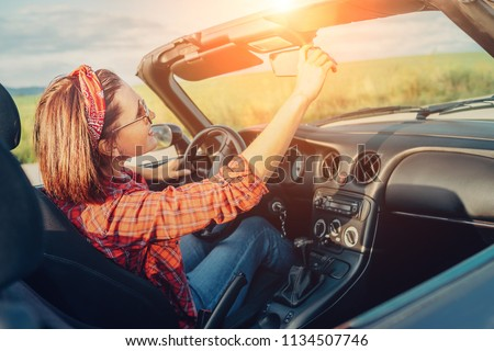 Woman drive cabriolet