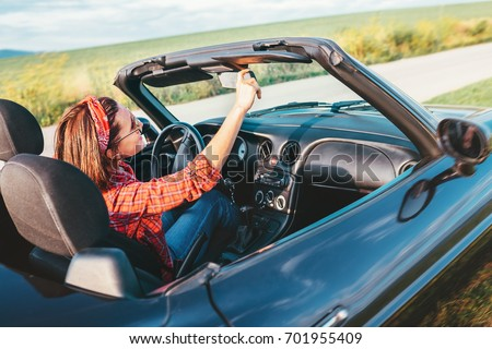 Woman drives a cabriolet car