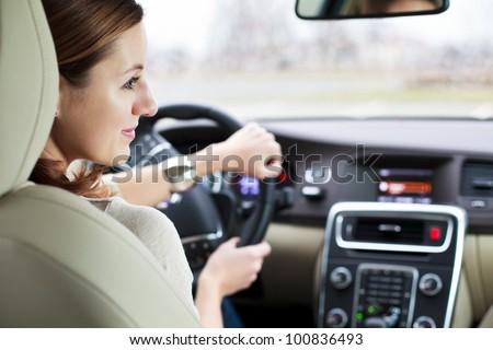 woman driving a car - stock photo