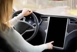 Woman driving new and modern car