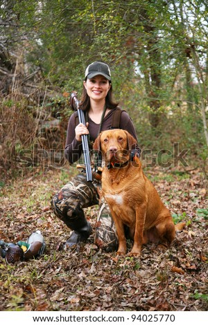 Woman Duck Hunter Portrait with Labrador and Decoys - stock photo