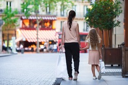 Woman during the shopping with the little adorable girl in Paris outdoors