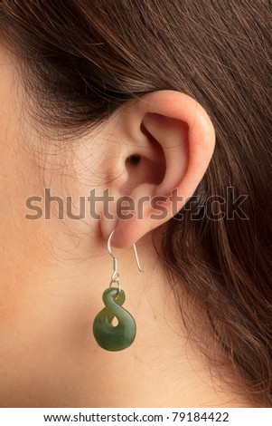Woman ear with earring