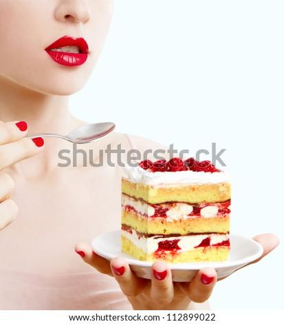 woman eating a fruit cake