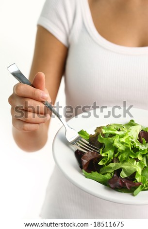 Woman eating fresh salad