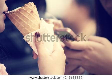 Woman eating ice cream cone