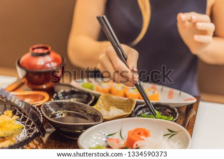 Woman eating japanese food in a japanese food restaurant #1334590373