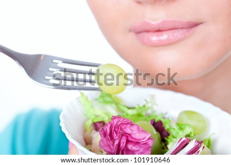 Woman eating salad, diet concept