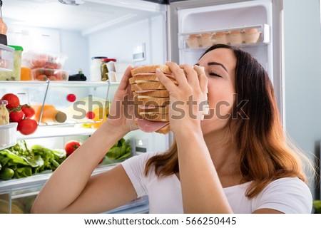 Shutterstock Woman Eating Sandwich
