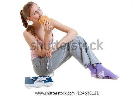 woman eats burger thinking about Weight loss