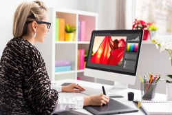 Woman editing photo on computer