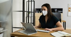 Woman Employee In Office Wearing FFP2 Face Mask Working On Computer
