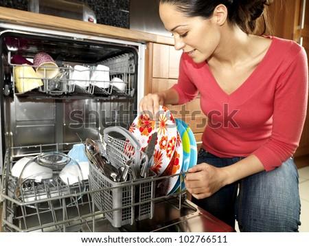 Woman Emptying a Dishwasher