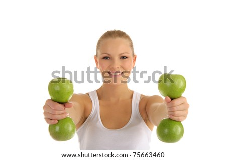 woman engaged in fitness dumbbells from apples isolated on white