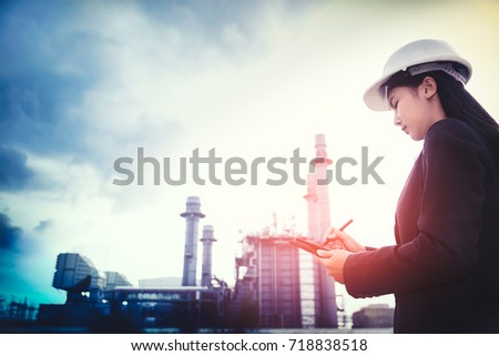 woman engineer and men engineer working new project in power plant #718838518
