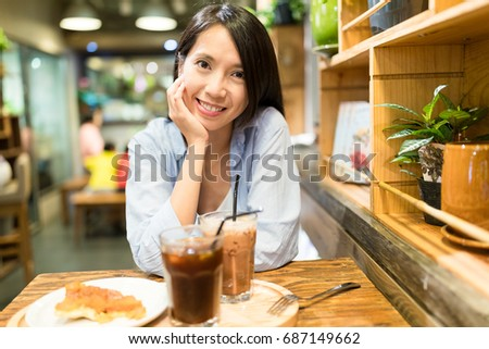 Woman enjoy her food in coffee shop #687149662