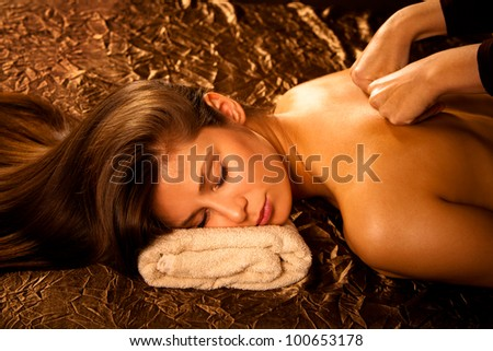 woman enjoy in  back massage in spa