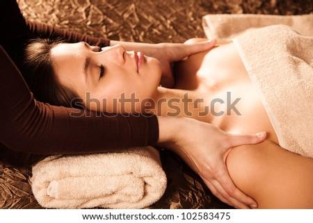 woman enjoy in shoulder massage in spa salon - stock photo