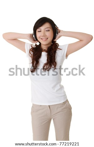 Woman enjoy music by headphone, full length portrait isolated on white background.