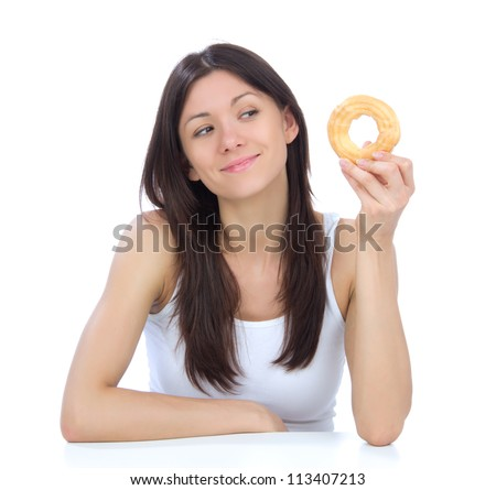 Woman enjoy sweet donut. Unhealthy junk food concept isolated on a white background