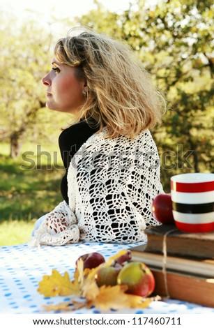 Woman enjoyed with sun light on autumn picnic - stock photo