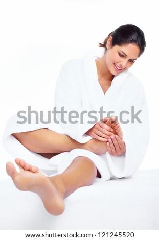 Woman enjoying a feet massage in a spa salon.