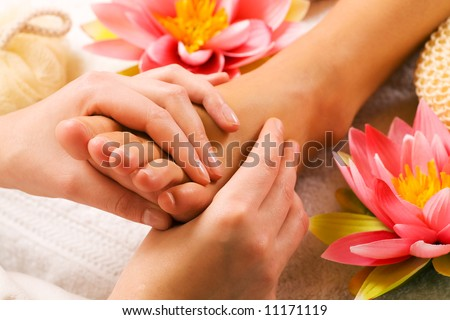 Woman enjoying a feet massage in a spa setting close up on feet