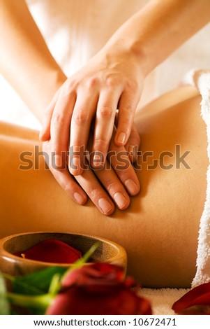Woman enjoying a massage in a spa setting